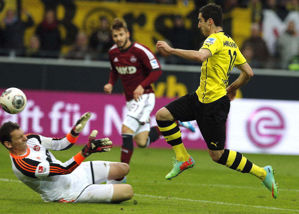 Photo - Dortmund's Henrikh Mkhitaryan of Armenia, right, fails to ecore against Nuremberg goalkeeper Raphael Schaefer  during the German first division Bundesliga soccer match between BvB Borussia Dortmund and 1.FC Nuremberg in Dortmund, Germany, Saturday, March 1, 2014. (AP Photo/Frank Augstein)