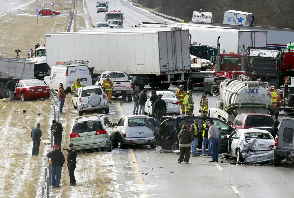 Semi-trucks and other vehicles involved in a mulit-car crash are strewn across westbound Interstate 275 between Colerain Avenue and Hamilton Avenue Monday, Jan. 21, 2013 in Cincinnati. The accident left about 20 people injured. There have been three separate highway pileups involving dozens of vehicles in Ohio. Authorities say as many as 50 vehicles could be involved in a pileup on Interstate 75 in southwest Ohio.  (AP Photo/Cincinatti Enquirer, Cara Owsley) NO SALES