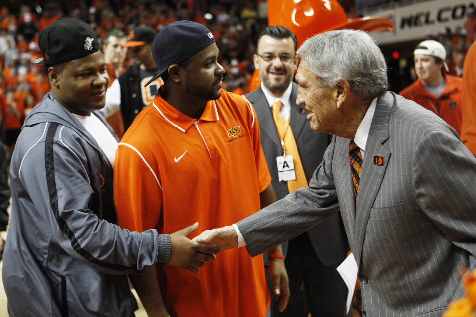 "Photo - Legendary Oklahoma State coach Eddie Sutton talks with former player Byron Eaton (left) after Sutton was honored at half time of an NCAA college basketball game between Oklahoma State University (OSU) and Iowa State at Gallagher-Iba Arena in Stillwater, Okla., Monday, Feb. 3, 2014. The event was proclaimed ""Eddie Sutton Night"" in honor of Sutton's years of coaching the Cowboys. Photo by KT King, The Oklahoman"