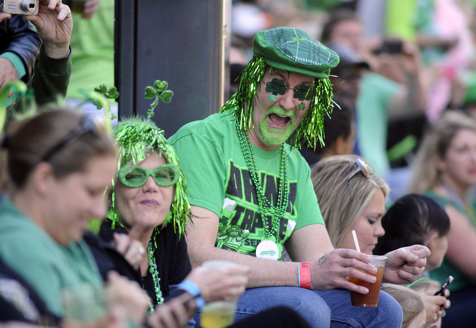 Photo - Gaudy green revelers crammed the oak-shaded sidewalks of downtown Savannah for the St. Patrick's Day parade, Saturday, March, 16, 2013, in Savannah, Ga. The St. Patrick's Day celebration is a 189-year-old tradition in Georgia's oldest city.  (AP Photo/Stephen Morton)