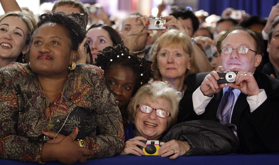 Photo - FILE - Dr. Ruth Westheimer, center, in the front-row watches President Barack Obama and first lady Michelle Obama at the Western Inaugural Ball in Washington, in this Jan. 20, 2009 file photo. The sideline events throughout inauguration weekend are the big draws for advocates and lobbyists looking to rub elbows with lawmakers and administration officials. The events at restaurants and hotels, museums and mansions are opportunities for anyone willing to write a check to turn a night out into a chance to build a Rolodex of Washington's powerbrokers. (AP Photo/Pablo Martinez Monsivais, File)
