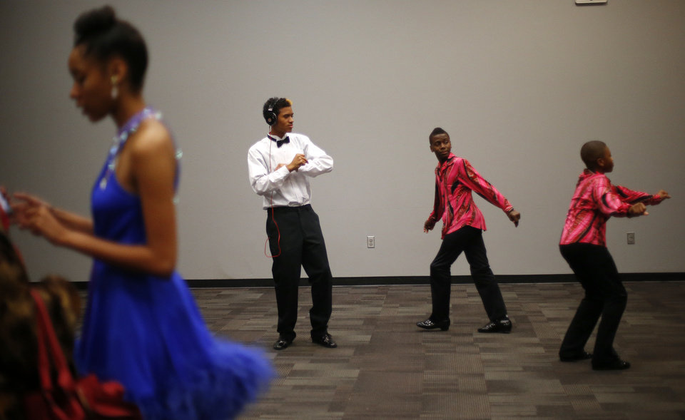Photo - James Cotton, 17, of John Marshall High School, passes time backstage at a dance competition at the Rose State Performing Arts Theatre in Midwest City. Photo by Bryan Terry, The Oklahoman  BRYAN TERRY - THE OKLAHOMAN