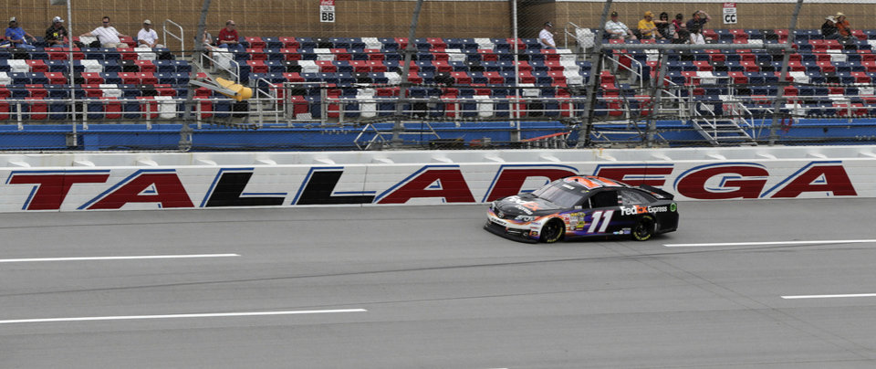 Driver Denny Hamlin drives through the tri-oval during practice for Sunday's NASCAR Sprint Cup series auto race at the Talladega Superspeedway in Talladega, Ala., Friday, May 3, 2013. Hamlin has been cleared by NASCAR to drive this week at Talladega following an injury he suffered at California. (AP Photo/Dave Martin)