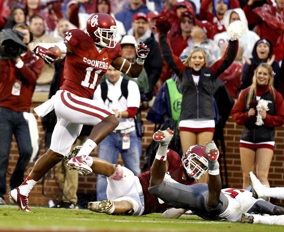 Oklahoma's Lacoltan Bester (11) scores on a long run during a college football game where  the University of Oklahoma Sooners (OU) defeated the Texas Tech Red Raiders 38-30 at Gaylord Family-Oklahoma Memorial Stadium in Norman, Okla., on Saturday, Oct. 26, 2013. Photo by Steve Sisney, The Oklahoman