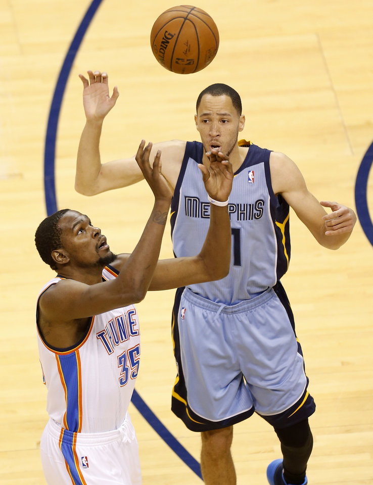 Photo - Oklahoma City's Kevin Durant (35) reaches for the ball on front of Memphis' Tayshaun Prince (21) during Game 5 in the first round of the NBA playoffs between the Oklahoma City Thunder and the Memphis Grizzlies at Chesapeake Energy Arena in Oklahoma City, Tuesday, April 29, 2014. Photo by Nate Billings, The Oklahoman