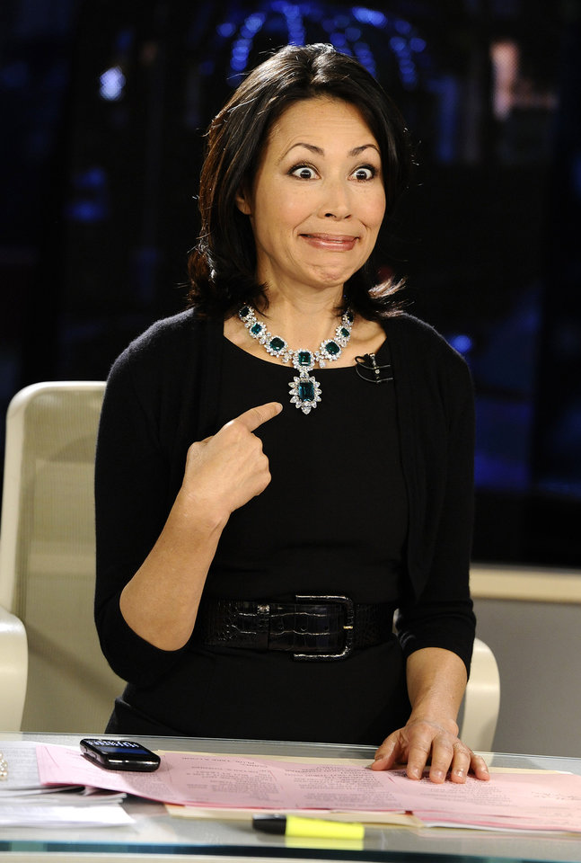 Photo -   This Sept. 7, 2011 photo released by NBC shows co-host Ann Curry modeling one of Elizabeth Taylor's necklaces, which was auctioned by Christie's, on the