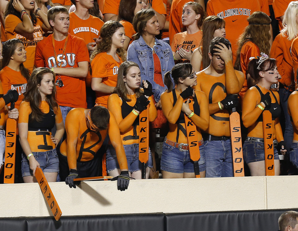 Photo - OSU fans react during the first half of OSU's 41-36 loss during a college football game between Oklahoma State University (OSU) and the University of Texas (UT) at Boone Pickens Stadium in Stillwater, Okla., Saturday, Sept. 29, 2012. Photo by Bryan Terry, The Oklahoman