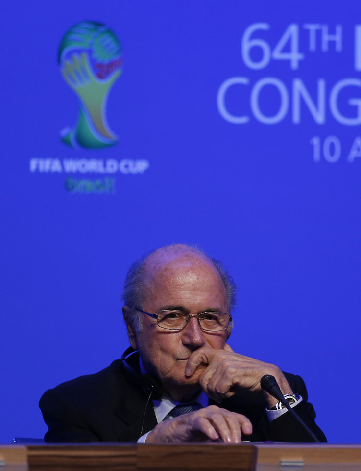 Photo - FIFA President Joseph Blatter attends a news conference following the FIFA Congress in Sao Paulo, Brazil, Wednesday, June 11, 2014. Brazil is hosting the 2014 soccer World Cup starting June 12. (AP Photo/Julio Cortez)
