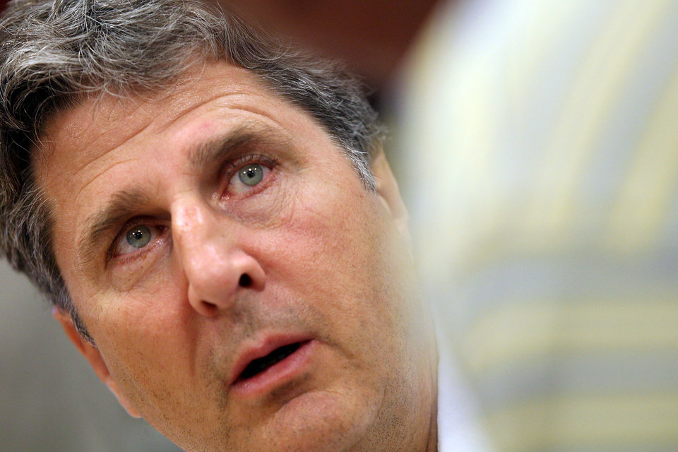 Former Texas Tech football coach Mike Leach talks to a fan during a book signing at a Barnes & Noble on Tuesday, July 19, 2011, in Lubbock, Texas. Leach says his book is more about his career than his firing because he started writing it before he was dismissed amid accusations he mistreated a player with a concussion. (AP Photo/The Avalanche-Journal, Miranda Grubbs) ORG XMIT: TXLUB102