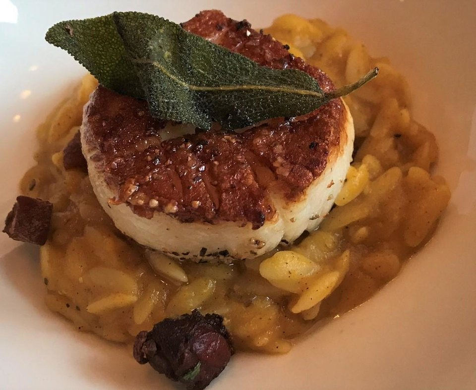 Photo - Seared scallop over butternut squash risotto from Patrono. [Dave Cathey/The Oklahoman]