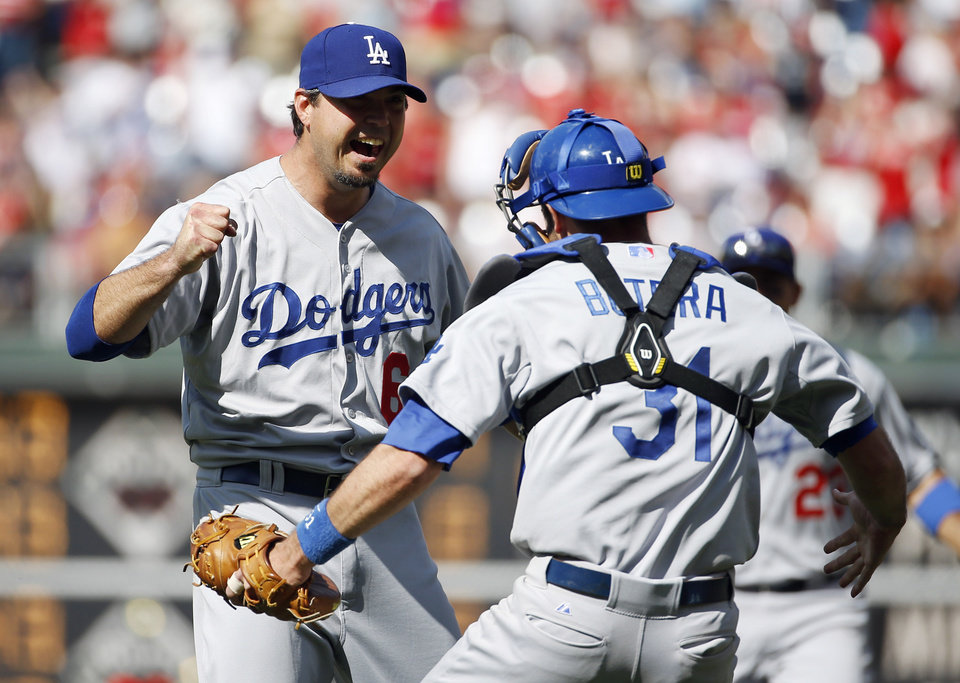 Photo - Los Angeles Dodgers starting pitcher Josh Beckett, left, celebrates with catcher Drew Butera after striking out Philadelphia Phillies' Chase Utley looking for a no-hitter baseball game, Sunday, May 25, 2014, in Philadelphia. Los Angeles won 6-0. (AP Photo/Matt Slocum)