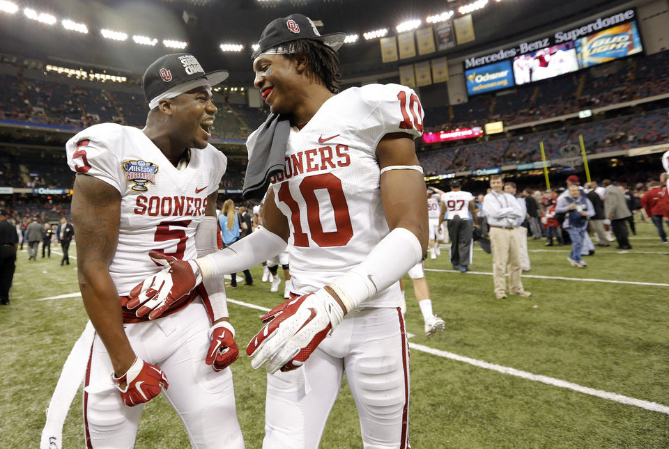 Photo - Oklahoma's Durron Neal (5) and Quentin Hayes (10) celebrate after the 45-31 win over Alabama during the NCAA football BCS Sugar Bowl game between the University of Oklahoma Sooners (OU) and the University of Alabama Crimson Tide (UA) at the Superdome in New Orleans, La., Thursday, Jan. 2, 2014.  .Photo by Chris Landsberger, The Oklahoman