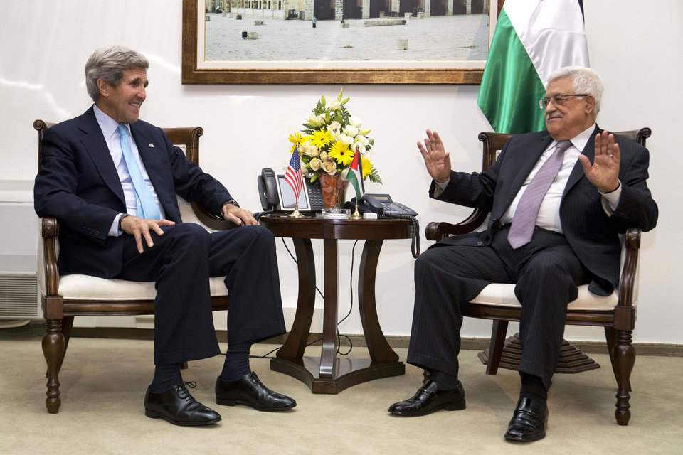 Photo - U.S. Secretary of State John Kerry, left, meets with Palestinian President Mahmoud Abbas inside Muqataa, the Palestinian Presidential compound in the West Bank town of Ramallah, on Sunday, June 30, 2013. Kerry, engaged in breakneck shuttle diplomacy to coax Israel and the Palestinians back into peace talks, drove to the West Bank on Sunday to have a third meeting in as many days with Abbas. (AP Photo/Jacquelyn Martin, Pool)