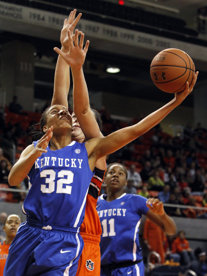 Photo - Kentucky's Kastine Evans (32) is fouled by Auburn's Peyton Davis while shooting during the first half of an NCAA college basketball game on Sunday, Jan. 19, 2014, in Auburn, Ala. (AP Photo/Butch Dill)