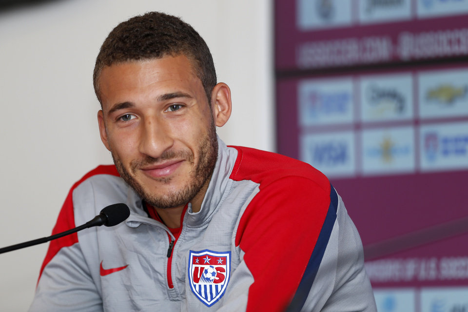 Photo - United States' Fabian Johnson attends a news conference at the Sao Paulo FC training center in Sao Paulo, Brazil, Tuesday, June 10, 2014. The U.S. will play in group G of the 2014 soccer World Cup. (AP Photo/Julio Cortez)