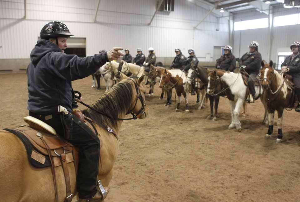 Deputy Randy Garner gives instructions during an annual training event to qualify deputies and horses for the Oklahoma County Sheriff's Office Mounted Patrol Division at State Fair Park in Oklahoma City, OK, Saturday, March 5, 2011. By Paul Hellstern, The Oklahoman ORG XMIT: KOD