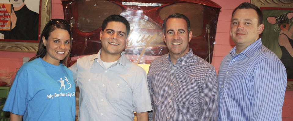 Photo - Mikaele Borecky, area director of Big Brothers Big Sisters of Oklahoma, Norman; Damian Guerrero, Chuy's restaurant area supervisor; Dirk O'Hara, the organization's governing board member and immediate past chairman; Carl McCauley, Chuy's Norman owner and operator team up to raise more than $4,600 for the nonprofit group at a pre-opening charity event at the restaurant. Photo provided