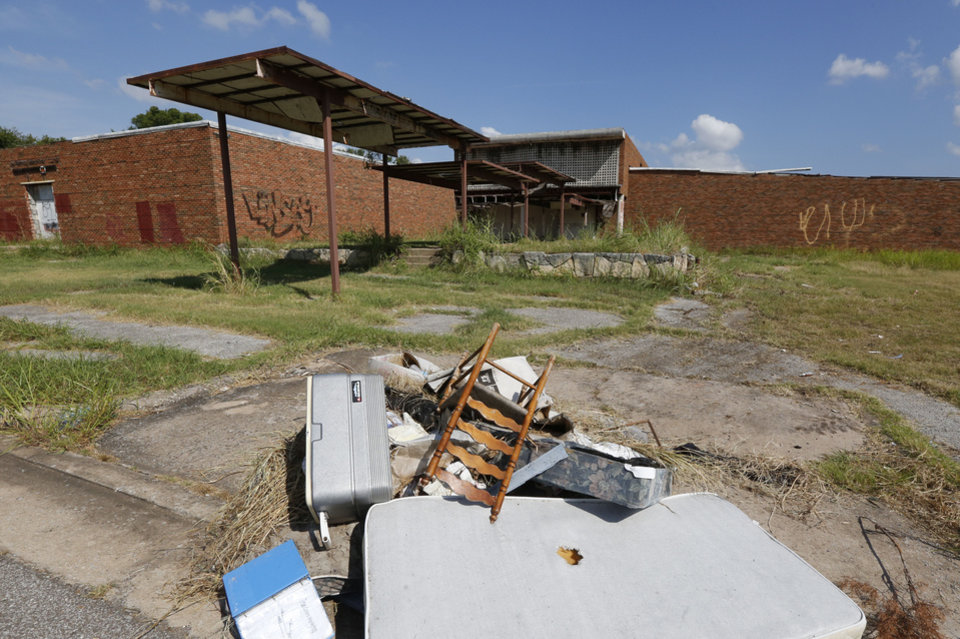 Photo -  Trash litters the area around the Bryant Center, an abandoned property in northeast Oklahoma City. [Photo by Paul Hellstern, The Oklahoman]