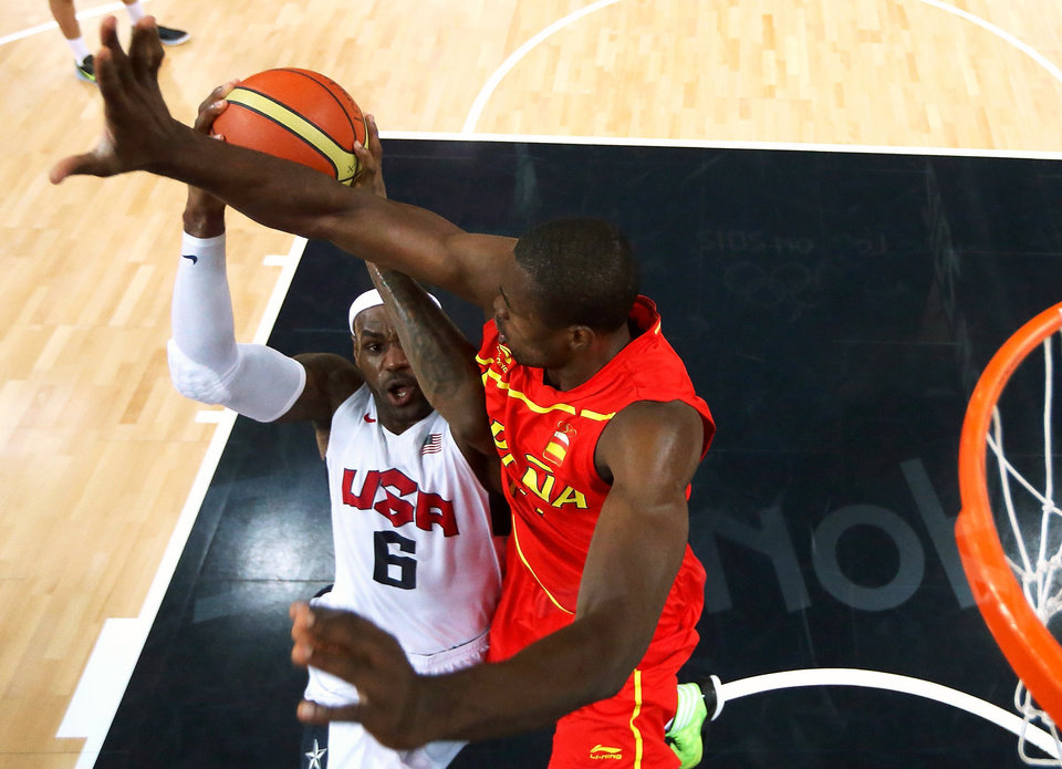 United States\' LeBron James (6) drives to the basket against Spain\'s Serge Ibaka during the men\'s gold medal basketball game at the 2012 Summer Olympics in London on Sunday, Aug. 12, 2012. (AP Photo/Christian Petersen, Pool)