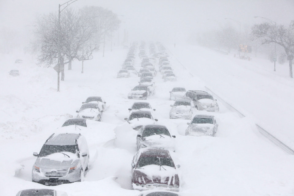 Photo - FILE - In this Feb. 2, 2011 file photo, hundreds of cars are seen stranded on Lake Shore Drive in Chicago. Global warming is rapidly turning America the beautiful into America the stormy, sneezy and dangerous,  according to a new U.S. federal scientific report released Tuesday, May 6, 2014. (AP Photo/Kiichiro Sato)
