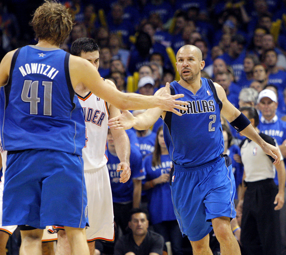 Photo - Jason Kidd and Dirk Nowitzki (41) of Dallas  celebrate after Kidd's three-point shot with less than a minute left in overtime during game 4 of the Western Conference Finals in the NBA basketball playoffs between the Dallas Mavericks and the Oklahoma City Thunder at the Oklahoma City Arena in downtown Oklahoma City, Monday, May 23, 2011. The Thunder lost game 3 to the Mavericks 112-105. Photo by John Clanton, The Oklahoman