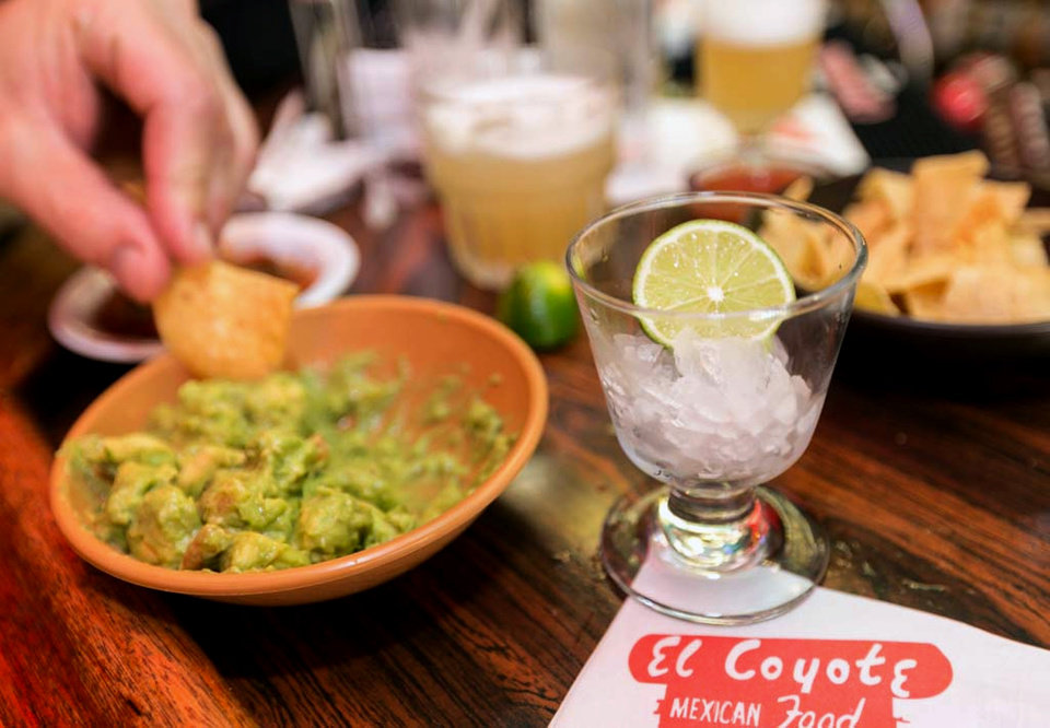 Photo - In this Monday, April 28, 2014 photo, a small glass is presented with a lime requested to flavor a guacamole appetizer at the bar of El Coyote, a Mexican restaurant in Los Angeles. Thousands of restaurateurs from coast to coast who have fallen victim to the Great Green Citrus Crisis of 2014. The price of a lime has skyrocketed in recent weeks, quadrupling or, in some areas, going even higher. (AP Photo)