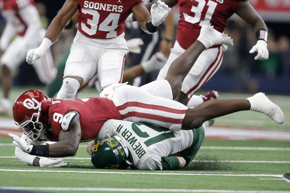 Photo - Oklahoma's Kenneth Murray (9) brings down Baylor's Charlie Brewer (12) during the Big 12 Championship Game between the University of Oklahoma Sooners (OU) and the Baylor University Bears at AT&T Stadium in Arlington, Texas, Saturday, Dec. 7, 2019. [Bryan Terry/The Oklahoman]