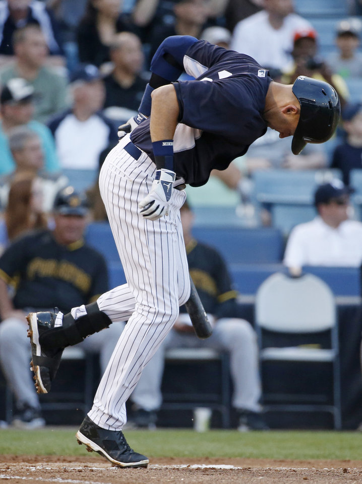 Photo - New York Yankees Derek Jeter limps after hitting himself a foul ball off his foot in the first inning of a spring exhibition baseball game against the Pittsburgh Pirates in Tampa, Fla., Friday, March 21, 2014.  Jeter stayed in the game in spite of the apparent re-injury of his left ankle. (AP Photo/Kathy Willens)