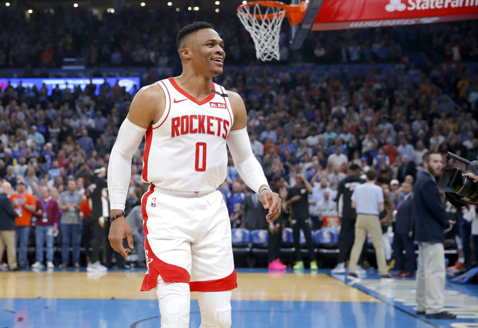 Photo - Houston's Russell Westbrook (0) cheers before the NBA basketball game between the Oklahoma City Thunder and the Houston Rockets at the Chesapeake Energy Arena in Oklahoma City,  Thursday, Jan. 9, 2020.  [Sarah Phipps/The Oklahoman]