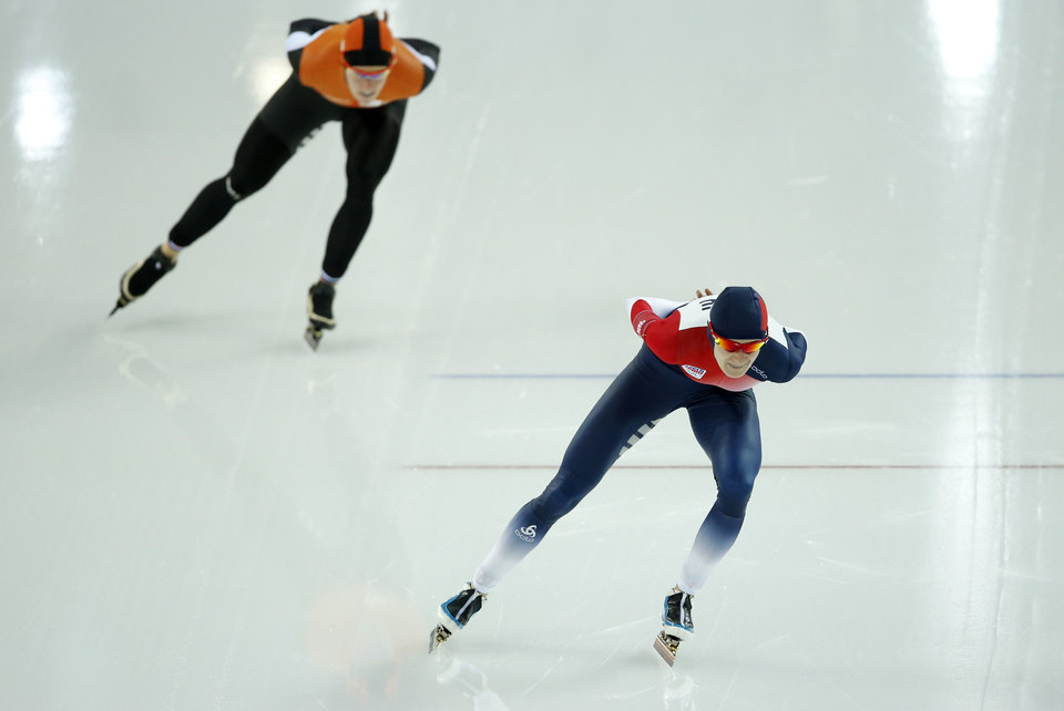 Photo - Gold medallist Martina Sablikova of the Czech Republic, right, and silver medallist Ireen Wust of the Netherlands compete in the women's 5,000-meter speedskating race at the Adler Arena Skating Center during the 2014 Winter Olympics In Sochi, Russia, Wednesday, Feb. 19, 2014. (AP Photo/Pavel Golovkin)