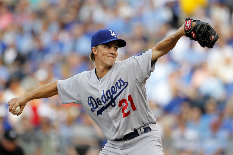 Photo - Los Angeles Dodgers pitcher Zack Greinke throws to a batter in the first inning of a baseball game against the the Kansas City Royals at Kauffman Stadium in Kansas City, Mo., Monday, June 23, 2014.  (AP Photo/Colin E. Braley)