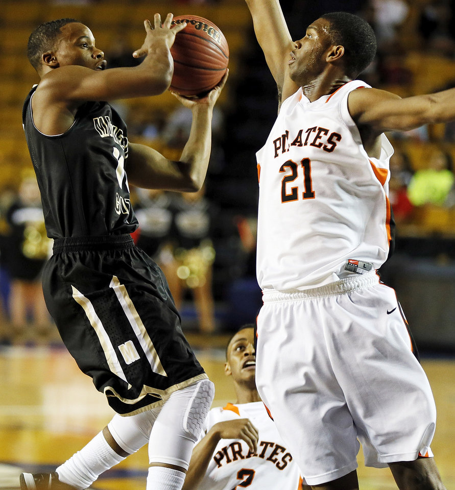Midwest City's Torey Noel (10) shoots against Orlando Goldsmith (21) of Putnam City during a Class 6A boys high school basketball game in the semifinals of the state tournament at the Mabee Center in Tulsa, Okla., Friday, March 8, 2013. Photo by Nate Billings, The Oklahoman