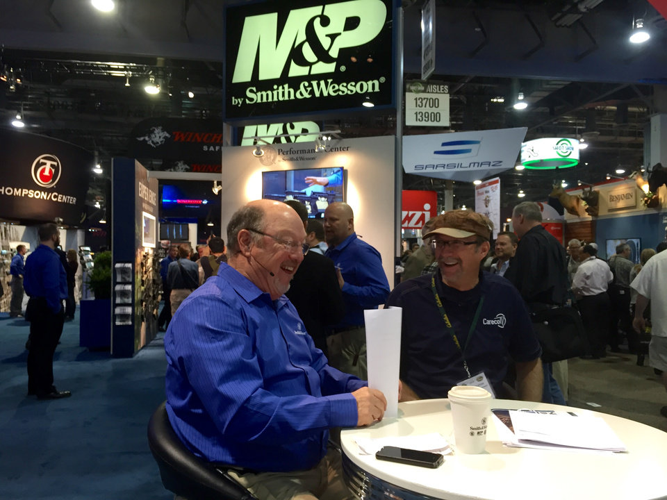 "Photo -  Former Ardmore resident and outdoors personality Wade Middleton (right) talks with Gary Giudice of Norman on Smith and Wesson's webcast ""Inside the Chamber"" from the 2015 SHOT Show in Las Vegas."