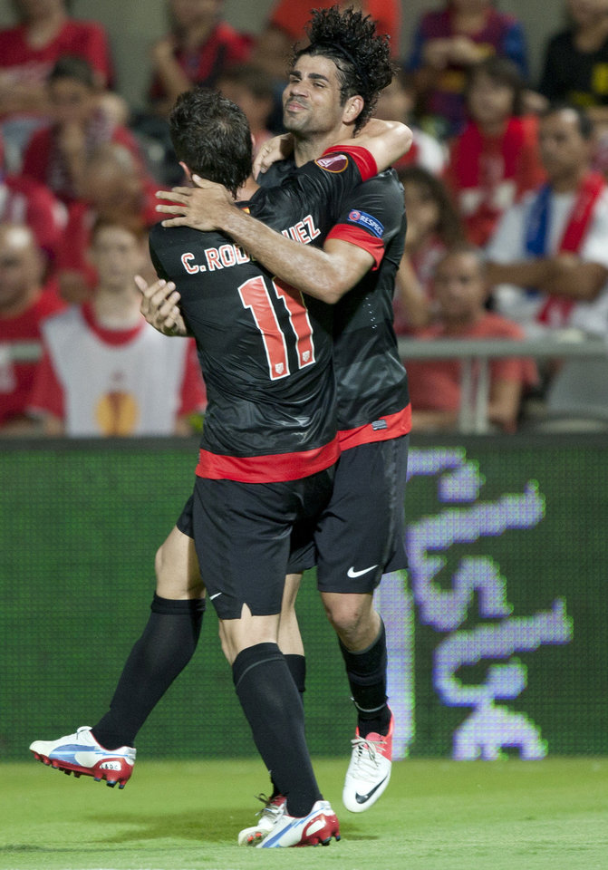 Photo -   Atletico Madrid's Diego Costa, right, celebrates a goal with Atletico Madrid's Cristian Rodríguez during their Europa League Group B soccer match against Hapoel Tel Aviv at the Bloomfield stadium in Tel Aviv, Israel,Thursday, Sept. 20, 2012. (AP Photo/Ariel Schalit)