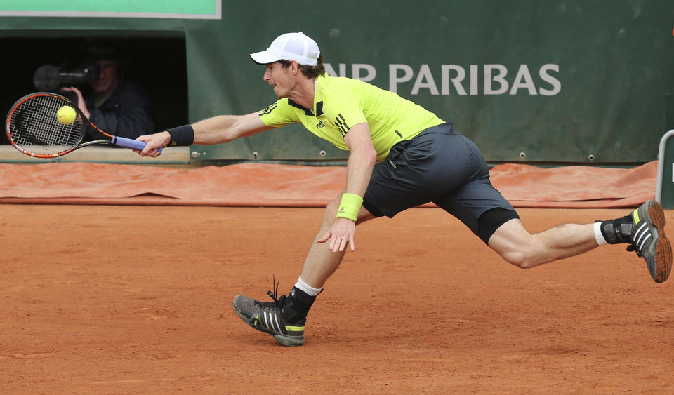 Photo - Britain's Andy Murray tries to return the ball to Kazakhstan's Andrey Golubev during the first round match of  the French Open tennis tournament at the Roland Garros stadium, in Paris, France, Tuesday, May 27, 2014. (AP Photo/David Vincent)