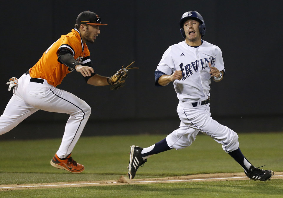 Photo - UC Irvine's Justin Castro (2) tries to avoid the tag of OSU's Tanner Krietemeier (16) as he gets caught in a run down between third base and home plate in the bottom of the second inning during Game 2 of the NCAA baseball Stillwater Super Regional between Oklahoma State and UC Irvine at Allie P. Reynolds Stadium in Stillwater, Okla., Saturday, June 7, 2014. Photo by Nate Billings, The Oklahoman