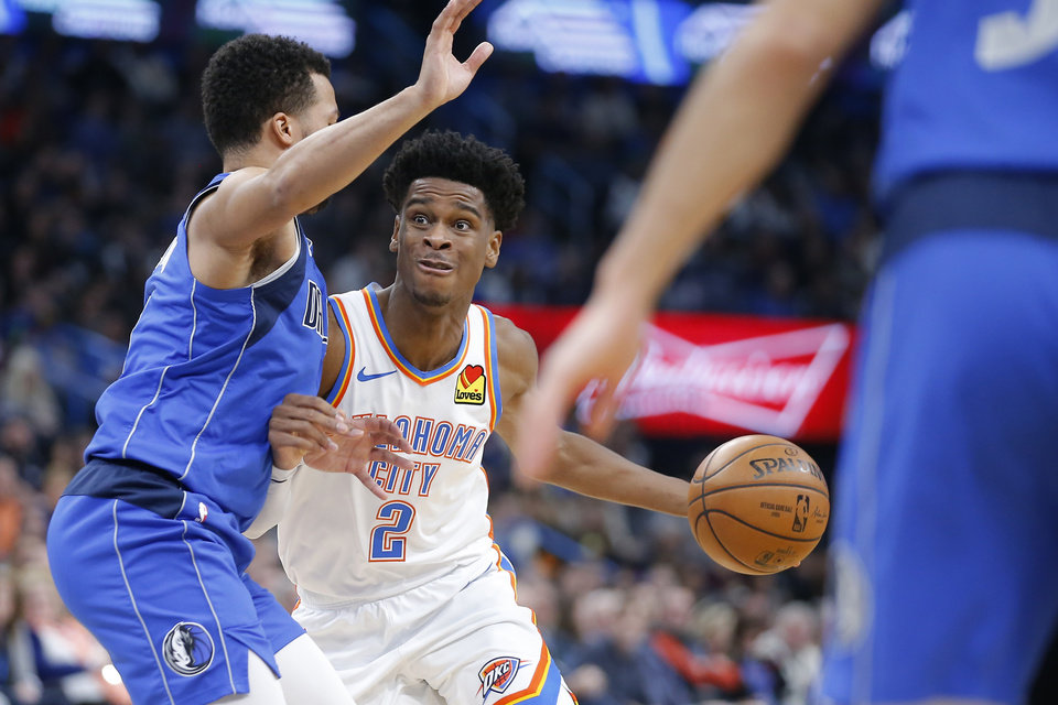 Photo - Oklahoma City's Shai Gilgeous-Alexander (2) goes past Jalen Brunson (13) of Dallas during an NBA basketball game between the Oklahoma City Thunder and the Dallas Mavericks at Chesapeake Energy Arena in Oklahoma City, Tuesday, Dec. 31, 2019. Oklahoma City won 106-101. [Bryan Terry/The Oklahoman]