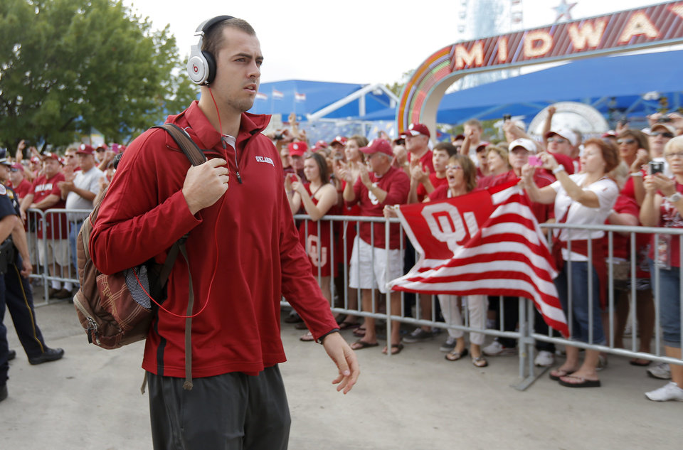 Photo - OU's Landry Jones arrives for the Red River Rivalry college football game between the University of Oklahoma (OU) and the University of Texas (UT) at the Cotton Bowl in Dallas, Saturday, Oct. 13, 2012. Photo by Bryan Terry, The Oklahoman