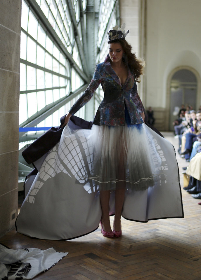 Photo -   A model shows a creation by French fashion designer Karim Bonnet as part of Impasse de la Defense ready to wear Spring-Summer 2013 collection, presented in Paris, Tuesday, Sept.25, 2012. (AP Photo/Thibault Camus)