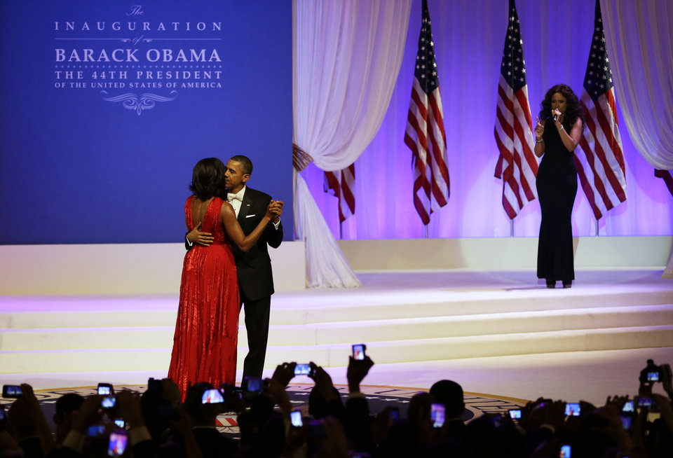 Photo - Jennifer Hudson, right, sings while President Barack Obama and first lady Michelle Obama dance at Commander-in-Chief's Inaugural Ball at the 57th Presidential Inauguration in Washington, Monday, Jan. 21, 2013. (AP Photo/Jacquelyn Martin)