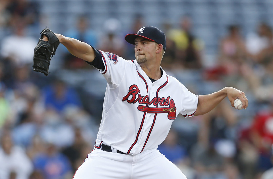 Photo - Atlanta Braves starting pitcher Mike Minor (36) works in the first inning of a baseball game against the New York Mets in Atlanta, Tuesday, July 1, 2014.  (AP Photo/John Bazemore)