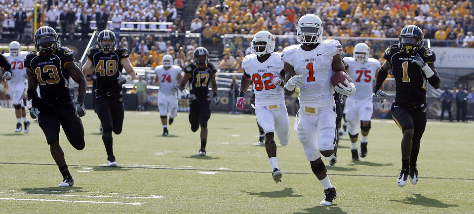 Photo - Oklahoma State's Joseph Randle (1) runs for a touchdown as the Missouri defense chases him during a college football game between the Oklahoma State University Cowboys (OSU) and the University of Missouri Tigers (Mizzou) at Faurot Field in Columbia, Mo., Saturday, Oct. 22, 2011. Photo by Sarah Phipps, The Oklahoman