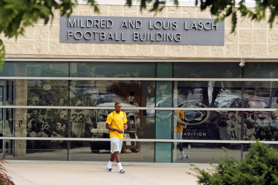 Photo -   FILE - In this July 12, 2012 file photo, a Penn State student leaves the Mildred and Louis Lasch Football Building on the Penn State University main campus in State College, Pa. After and eight-month inquiry, Former FBI director Louis Freeh's firm produced a 267-page report that concluded that Paterno and other top Penn State officials hushed up child sex abuse allegations against former Penn State assistant football coach Jerry Sandusky for more than a decade for fear of bad publicity, allowing Sandusky to prey on other youngsters. (AP Photo/Gene J. Puskar, File)