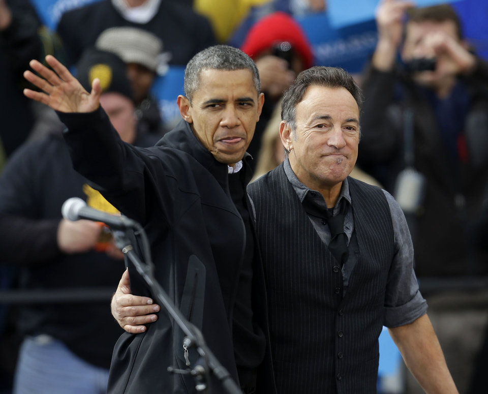 Photo -   President Barack Obama, accompanied by singer Bruce Springsteen, waves as he arrive at a campaign event near the State Capitol Building in Madison, Wis., Monday, Nov. 5, 2012. (AP Photo/Pablo Martinez Monsivais)
