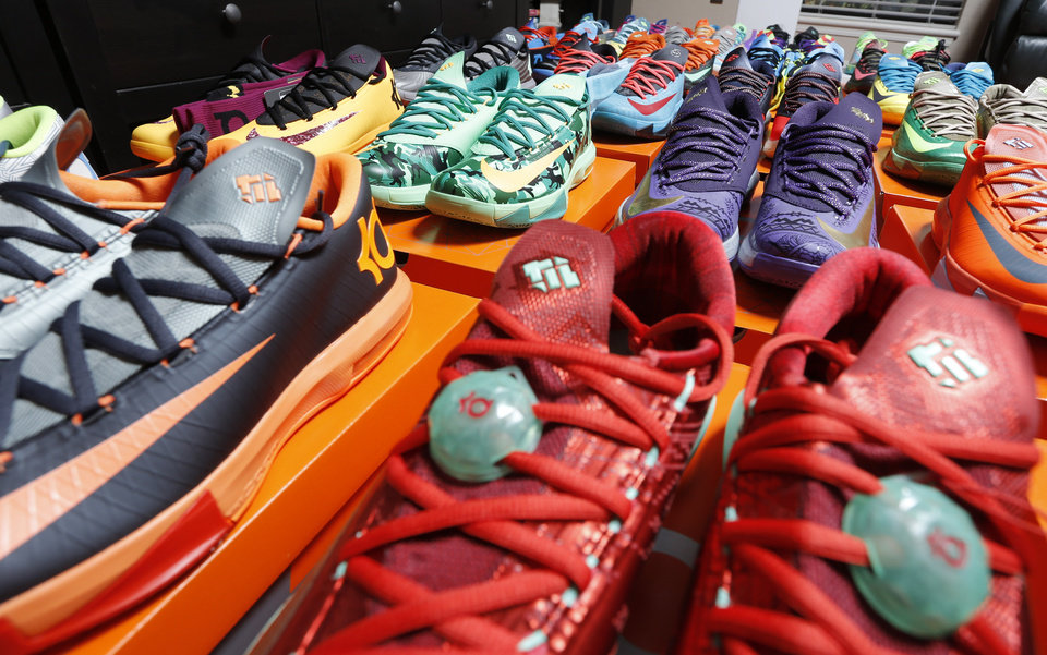 Photo - Christopher McCord and his complete collection of Nike KD 6 shoes Sunday, August 31, 2014. Photo by Doug Hoke, The Oklahoman