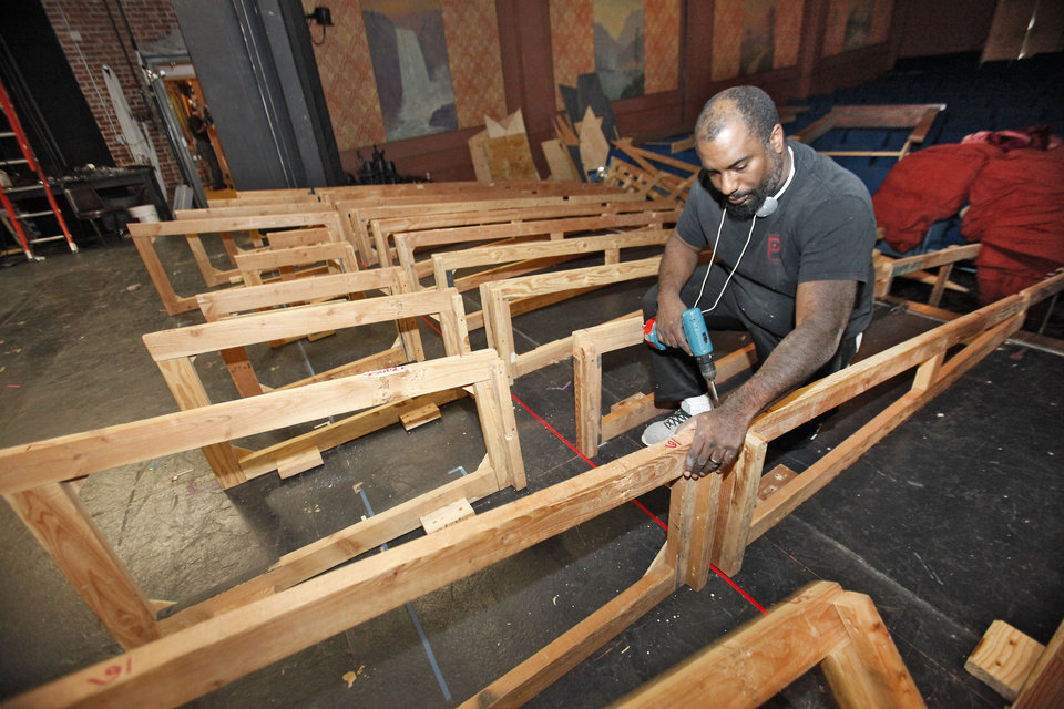 Pollard Theatre Artistic Director Jerome Stevenson works on the set for �A Territorial Christmas Carol.�  Photos by David McDaniel, The Oklahoman