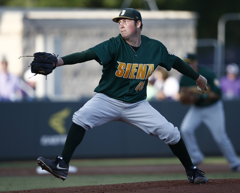 Photo - Siena starting pitcher Matt Gage delivers a pitch to TCU during the first inning of an NCAA college baseball regional tournament game in Fort Worth, Texas, Friday, May 30, 2014. (AP Photo/Jim Cowsert)