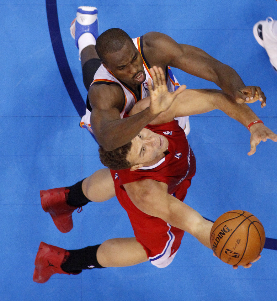 Oklahoma City's Serge Ibaka (9) blocks the shot of the Clippers' Blake Griffin (32) during an NBA basketball game between the Oklahoma City Thunder and the Los Angeles Clippers at Chesapeake Energy Arena in Oklahoma City, Thursday, Nov. 21, 2013. Oklahoma City won 105-91. Photo by Bryan Terry, The Oklahoman