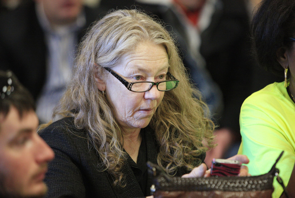 "Norma Sapp, director of he Oklahoma chapter of the National Organization for the Reform of Marijuana Laws (NORML), listens to State Sen. Constance Johnson, D-Forest Park, speak during a meeting in support of Senate Bill 2116 to legalize marijuana at the state Capitol in Oklahoma City Wednesday, Feb. 12, 2014.  Supporters converged on the state Capitol to personally lobby their legislators to reform Oklahoma's strict marijuana laws during ""Medical Marijuana Lobby Day."" Photo by Paul B. Southerland, The Oklahoman"