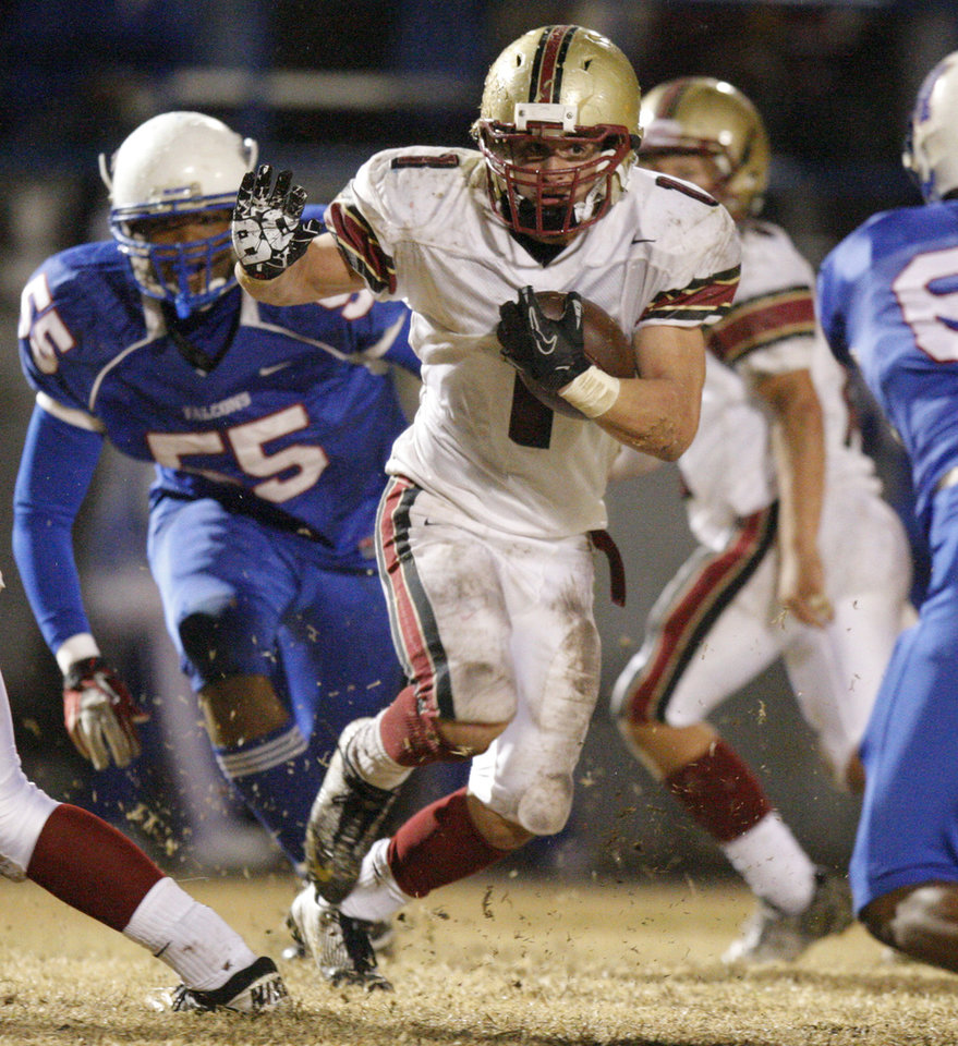 Lincoln Christian\'s Zack Simmons runs during a Class 2A high school football playoff game between Millwood and Lincoln Christian in Oklahoma City, Friday, Nov. 25, 2011. Photo by Bryan Terry, The Oklahoman